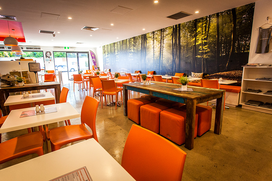 Paleo Cafe orange chairs