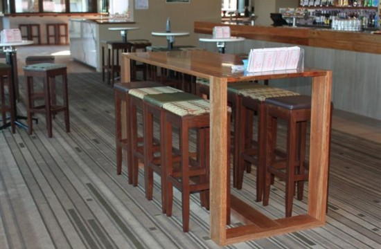 timber barstools in hotel interior