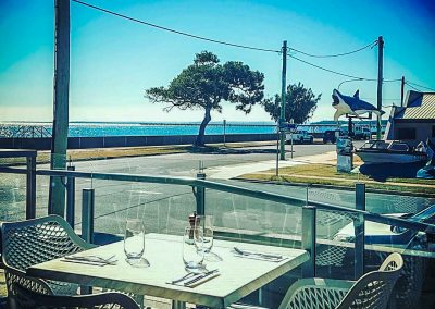 Vineyard Restaurant Bar in Hervey Bay - Tables, Air Xl Chairs and Ocean View