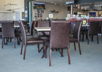 Bargara Golf Club - Florence Chair in Chocolate Vinyl & Gentas Marble Table Tops on Black Air Legs - Image 1