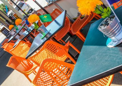 Cafe Dolcetto in Yass - Air Chair in Orange with Astoria Black Table Base & Gentas Duratop in Black - Image 2