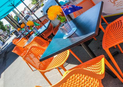 Cafe Dolcetto in Yass - Air Chair in Orange with Astoria Black Table Base & Gentas Duratop in Black - Image 3