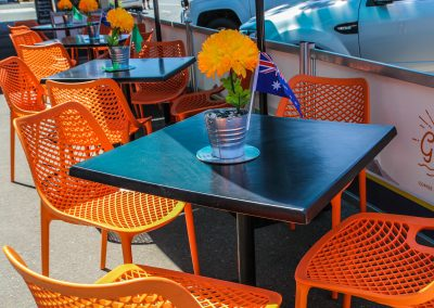 Cafe Dolcetto in Yass - Air Chair in Orange with Astoria Black Table Base & Gentas Duratop in Black - Image 4