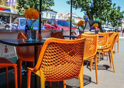Cafe Dolcetto in Yass - Air Chair in Orange with Astoria Black Table Base & Gentas Duratop in Black - Image 5