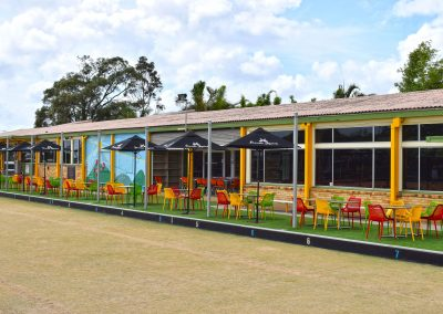 Camp Hill Bowls Club - Air Chair in Red, Mango, Green & Stirling MK2 Table Base with Compact Laminate Duratop in Shesman - Image 1