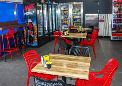 Hume Cafe Takeaway - Air Chair in Black & Red , Air Barstool in Black & Red with Gentas Shesman Duratop & Black Astoria Table Base - Image 2
