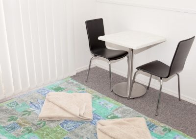 Redland Bay Motel - Avoca Chair - Black Pvc, Corio Mk2 Chair, Alexi S/S Table Base & Duratop Table Tops - Image 8