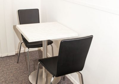 Redland Bay Motel - Avoca Chair - Black Pvc, Corio Mk2 Chair, Alexi S/S Table Base & Duratop Table Tops - Image 6