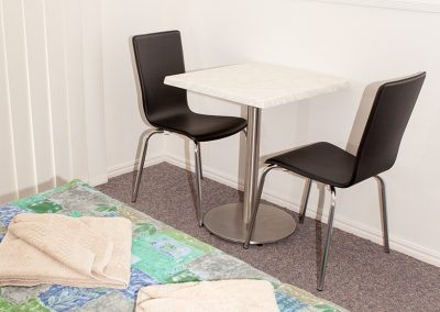 Redland Bay Motel - Avoca Chair - Black Pvc, Corio Mk2 Chair, Alexi S/S Table Base & Duratop Table Tops - Image 5