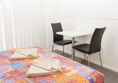 Redland Bay Motel - Avoca Chair - Black Pvc, Corio Mk2 Chair, Alexi S/S Table Base & Duratop Table Tops - Image 3