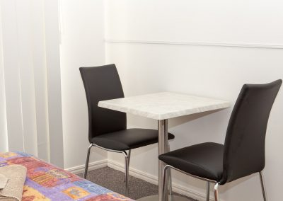 Redland Bay Motel - Avoca Chair - Black Pvc, Corio Mk2 Chair, Alexi S/S Table Base & Duratop Table Tops - Image 2
