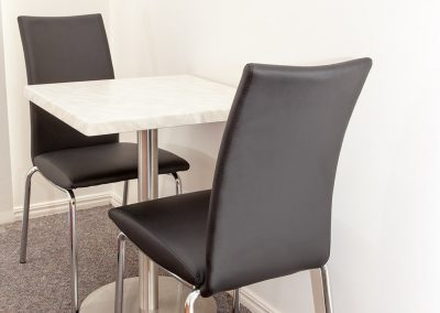 Redland Bay Motel - Avoca Chair - Black Pvc, Corio Mk2 Chair, Alexi S/S Table Base & Duratop Table Tops